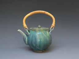 Faced Green Teapot by California potter Cliff Glover features a irregular rim which keeps the eye moving from top to bottom, left to right.