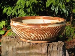 This serving bowl by potter Cliff Glover is an homage to the ancient Joman potters of Japan. Known as