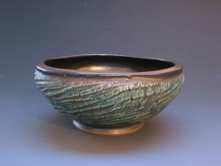 This outside of this serving bowl by potter Cliff Glover was textured with the sharp edge of a rib, rhythmically striking the surface of the clay, as the pot turned slowly on the wheel head.