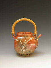 This teapot, by Albion potter Cliff Glover, is decorated with three different Shino glazes.